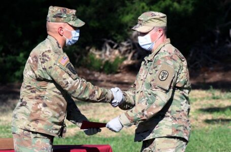 Maj. Roger Webb, a graduate of the U.S. Army Graduate Program in Anesthesia Nursing (USAGPAN), receives a diploma from Maj. Richard E. Crocker, director, USAGPAN, William Beaumont Army Medical Center, during WBAMC's 2020 GME graduation ceremony held at the North East law of the main campus, June 20. Graduates completed courses of study in residencies or internships in one of the following GME programs | DoD. photo by Vincent Byrd